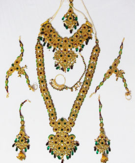 Red Green Gold Beads Stone Studded Eight Piece Bridal Set
